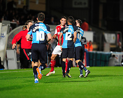 Wycombe Wanderers' Paris Cowan-Hall squares up to Bristol City's Stephen McLaughlin - Photo mandatory by-line: Joe Dent/JMP - Tel: Mobile: 07966 386802 08/10/2013 - SPORT - FOOTBALL - London Road Stadium - Peterborough - Peterborough United V Brentford - Johnstone Paint Trophy