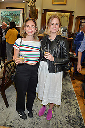Left to right, AYESHA SHAND and FLORA MacGREEVY at a private view of photographs by Gray Malin 'Beaches' held at Huntsman, 11Savile Row, London on 20th June 2016.