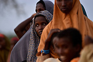 Hundreds of people fleeing drought, famine and a civil war in Somalia wait in line at dawn to register at Ifo refugee camp in Dadaab, Kenya. According to the United Nations, 3.7 million Somalis are in crisis.
