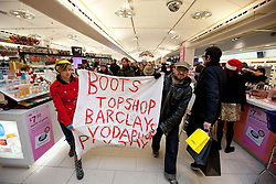 "© under license to London News Pictures. 18/12/2010: Approximately 25 protesters picketed Top Shop and other shops associated with Philip Green, Vodafone and Boots to highlight corporate tax-avoidance. Protesters walked through Boots, passed Christmas shoppers, with banners declaring it was ""Pay day"""