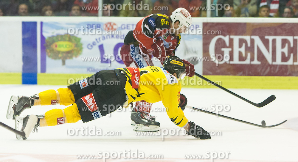 27.10.2013, Stadthalle, Klagenfurt, AUT, EBEL, EC KAC vs Vienna Capitals, 29. Runde, im Bild Patrik Peter (UPC Vienna Capitals, #14), Tylor Spurgeon (Kac, #9) // during the Erste Bank Icehockey League 29th Round match betweeen EC KAC and Vienna Capitals at the City Hall, Klagenfurt, Austria on 2013/10/27. EXPA Pictures © 2013, PhotoCredit: EXPA/ Gert Steinthaler