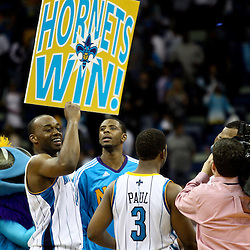 March 30, 2011; New Orleans, LA, USA; New Orleans Hornets power forward Carl Landry (24) celebrates along with small forward Patrick Ewing Jr. (22), point guard Chris Paul (3) and mascot Hugo following a win over the Portland Trail Blazers at the New Orleans Arena. The Hornets defeated the Trail Blazers 95-91.   Mandatory Credit: Derick E. Hingle