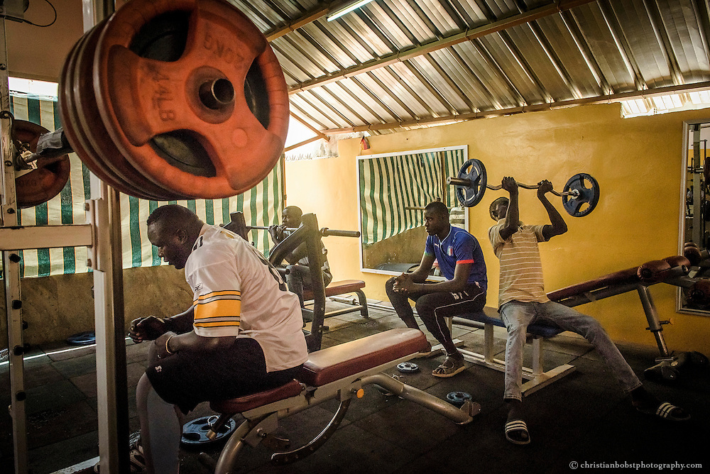 April 3, 2015. Not only the big wretling stars like Forza (left) train in the posh club Olympique in Dakar. The memebership prices at the club are almost as high as in some European countries.