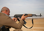 The Dads' Army fighting Isis: One-eyed veterans forced to fight jihadis with nothing but rusty AK47s from 1960 and wearing cast-offs from US army<br /> <br /> <br /> *The veterans have taken up arms in Iraqi towns threatened by ISIS <br /> <br /> *Among dysfunctional army are grandfathers and Gulf War soldiers <br /> <br /> *Rusty AK47s and second-hand grenades are their only weaponry  <br /> <br /> Weathered and war-weary, these are the Dad's Army warriors fighting to free a country for which many have fought before.<br /> They are the Kurdish volunteers on the battlefield of Iraq's bloody war against the Islamic State jihadis ravaging their homeland. <br /> And while many look like they'd better belong in line for a free bus pass than on the frontline, their advancing years belie their bravery.<br /> <br /> <br /> I meet them in the Iraqi town of Taza Kharmatho, just south of Kirkuk city, where war is raging. <br /> Dressed proudly in handed-down uniforms, they yield weapons leftover from bygone wars, including AK47s dating from the 1960s.<br /> One day, alongside a tank, Russian grenade launcher and a handful of machine guns, these were all they had to fight with.  <br /> <br /> By contrast, the ISIS fighters are armed with state-of-the-art weaponry stolen from the Iraqi army or seized from wayward U.S. airdrops meant for Peshmerga Kurds.<br /> <br /> Where these seasoned soldiers negotiate the muddy roads (we saw heavy rain for five days here) in four-wheel-drives, ISIS have hummers.<br /> Nevertheless, they have no choice but to fight with what they have - despite hollow promises from the U.S. and Europe to arm them adequately.<br /> One, who did not want to give his name but has returned to Iraq from London where he has lived for many years, told me his AK47 is indeed from the 1960s.<br /> 'My weapon is an AK47 that I saved up my own money for and bought on the black market to fight ISIS to save my country,' he tells me proudly, holding his rattling rifle with both hands. <br /> <br /> 'Of course we want better guns but we have no choice.<br /> 'Yes, we desperately need modern guns, any type would be bet