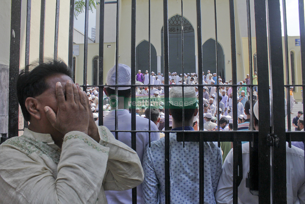 April 13, 2018 - Dhaka, Bangladesh - Islamic parties shout for justice. Hundreds of children have been killed in an Afghan air attack on a gathering at a religious school in the Northern Province of Kunduz, at April 13, 2018. One of the nonpolitical biggest Islamic party of Bangladesh Hefazot – E – Islam Bangladesh shouts for justice of killing of the children who were hafez. Moreover they demand to the Bangladeshi government to pass a Condemnation bill against America in the parliament. (Credit Image: © Khandaker Azizur Rahman Sumon/NurPhoto via ZUMA Press)