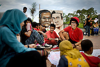 "Ruben, 20, right, hangs out with friends at an Aceh Youth Forum, which supports Aceh's youth through art and dance, during their third official show, in Banda Aceh, Indonesia, Monday, Nov. 16, 2009. The organization is comprised of 73 youth groups in Aceh Province. ""We are not afraid of Sharia Law because we do this for the development of Achnese youth,"" says Ocxie, 23, the organizer of the group."