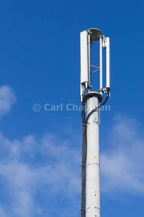 Compact 3 sector cellular telecom communications panel antenna array for the mobile telephone system on a cellsite pole tower .