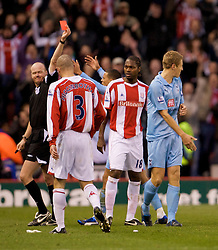 STOKE, ENGLAND - Sunday, October 19, 2008: Tottenham Hotspur's Michael Dawson looks dejected after being shown the red card and sent off by referee Lee Mason during the Premiership match against Stoke City at the Britannia Stadium. (Photo by David Rawcliffe/Propaganda)