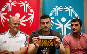 (L) Boguslaw Galazka - Director of Special Olympics Poland & (C) Legia's Michal Zewlakow & (R) Legia's Wladimer Dwaliszwili while official draw before Special Olympics's Football Tournament at Legia Stadium in Warsaw on May 22, 2013..The mission of Special Olympics is to provide sports training and athletic competition for children and adults with intellectual disabilities...Poland, Warsaw, May 22, 2013...Picture also available in RAW (NEF) or TIFF format on special request...For editorial use only. Any commercial or promotional use requires permission...Photo by © Adam Nurkiewicz / Mediasport