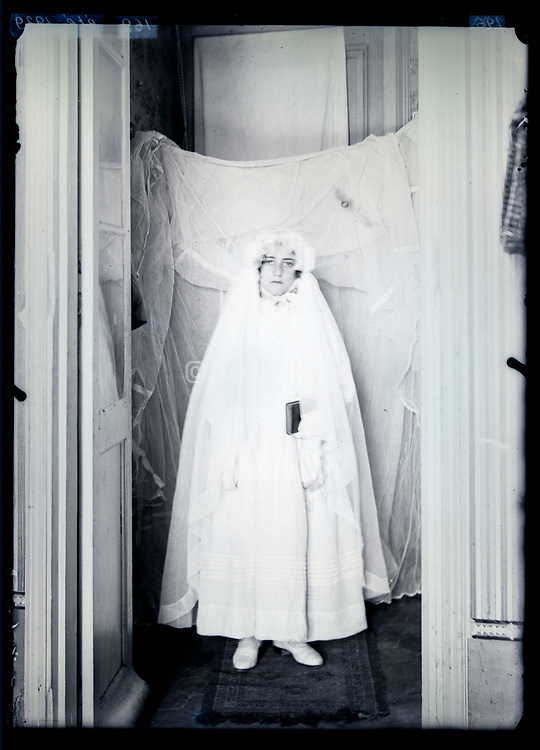 not to happy girl in holy communion dress France circa 1920s
