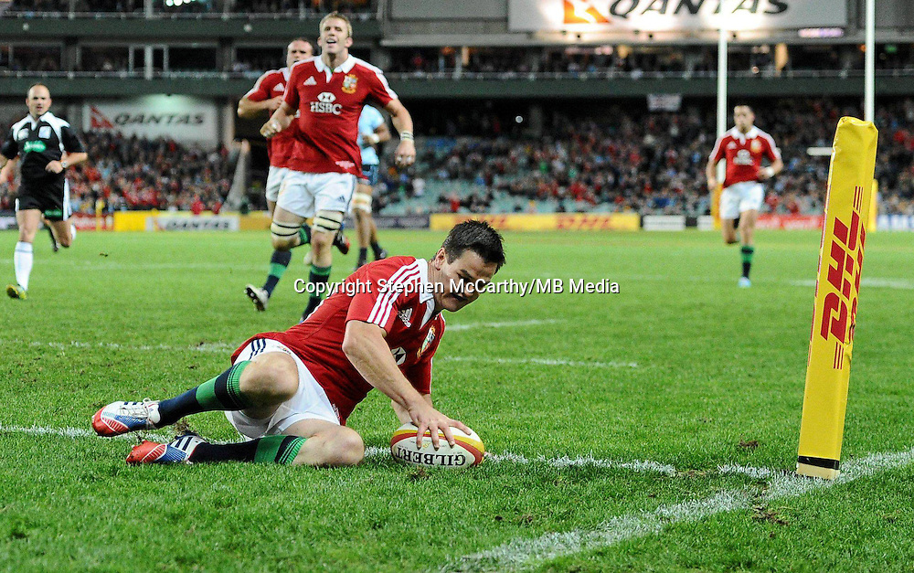 15 June 2013; Jonathan Sexton, British & Irish Lions, goes over to score his side's first try. British & Irish Lions Tour 2013, NSW Waratahs v British & Irish Lions, Allianz Stadium, Sydney, NSW, Australia. Picture credit: Stephen McCarthy / SPORTSFILE