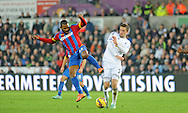 Jason Puncheon of Crystal Palace wins the ball despite the attentions of Gylfi Sigurdsson of Swansea City (r).<br /> Barclays Premier league match, Swansea city v Crystal Palace at the Liberty stadium in Swansea, South Wales on Saturday 29th November 2014<br /> pic by Phil Rees, Andrew Orchard sports photography.