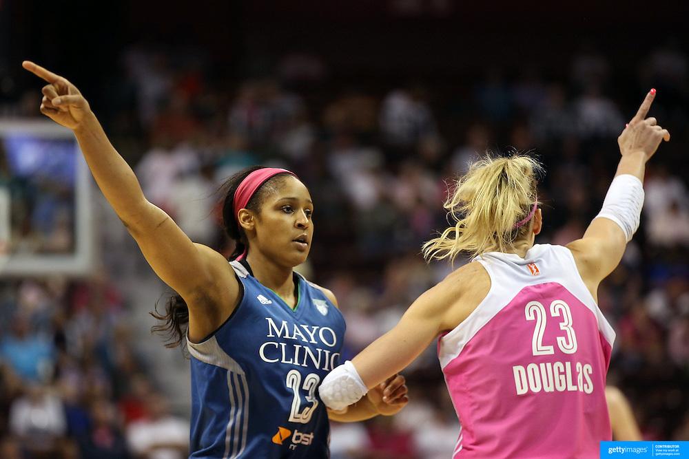 Maya Moore, (left), Minnesota Lynx and Katie Douglas, Connecticut Sun, in action during the Connecticut Sun Vs Minnesota Lynx, WNBA regular season game at Mohegan Sun Arena, Uncasville, Connecticut, USA. 27th July 2014. Photo Tim Clayton