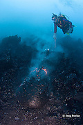 diver Bud Turpin and pillow lava erupting from underwater lava tube at ocean entry of Kilauea Volcano, Hawaii Island ( the Big Island ), Hawaii, U.S.A. ( Central Pacific Ocean ) MR 381
