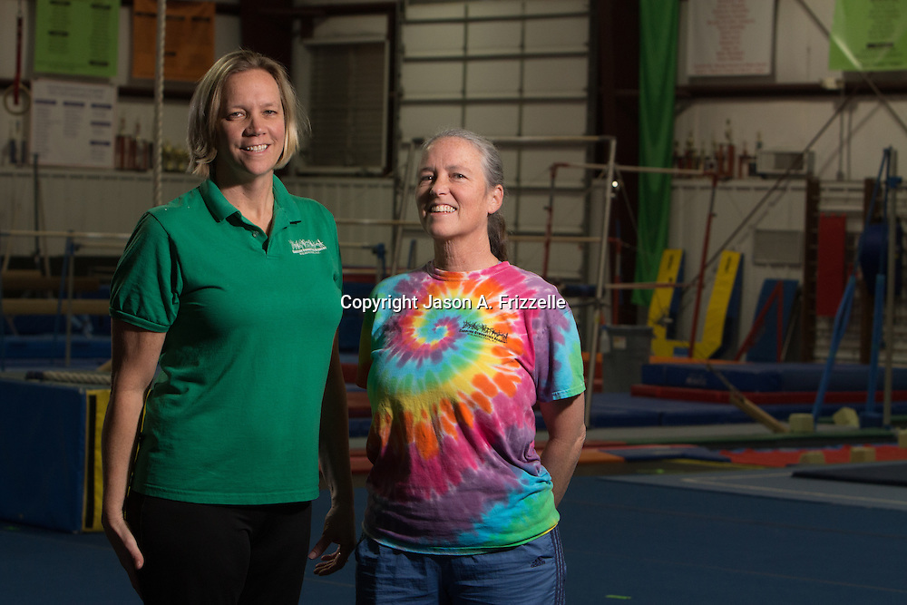 Rebecca Bishop, left and Michele Zapple, owners of Carolina Gymnastics Academy pose for a portrait at the academy Tuesday January 21, 2014.  (Jason A. Frizzelle)