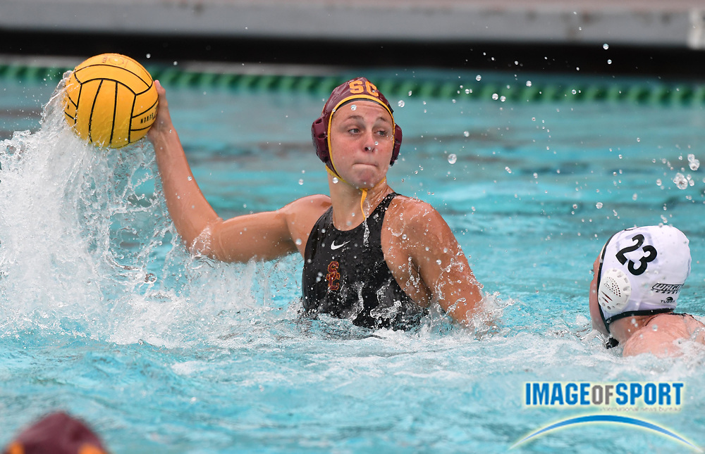 Southern California Trojans driver Denise Mammolito (8) is defended by Wagner Seahawks utility player Daisy Nankervis (23) during an NCAA college women's water polo quarterfinal game in Los Angeles, Friday, May 11, 2018. USC defeated Wagner 12-5.  (Kirby Lee via AP)