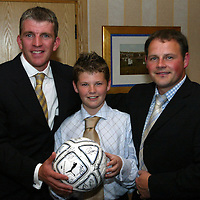 Jim Weir Testimonial...11.04.05<br />Jim with match ball sponsor Derek Flemming and son<br /><br />Picture by Graeme Hart.<br />Copyright Perthshire Picture Agency<br />Tel: 01738 623350  Mobile: 07990 594431