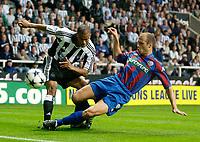 Photo. Jed Wee<br /> Newcastle United v Partizan Belgrade, European Champions League Qualifier, St. James' Park, Newcastle. 27/08/2003.<br /> Partizan's Igor Duljaj (R) slides in to dispossess Newcastle's Kieron Dyer.