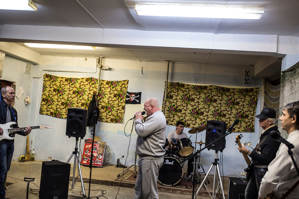 The band Hammer and Sickle, comprised of Grigory Grebenkin, Salavat Gabrullin, Valery Shekin, Pavel Lenkov, and singer Aleksei Pashenko, rehearses in the basement of a local school on Tuesday, November 12, 2013 in Asbest, Russia.