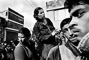 colombia1016 - Realtives wait outside Bogota?s Central Prison, while inside the police tries to stop a riot between paramilitary and guerrilla prisoners armed with automatic weapons and land mines..Bogota, july 2001.<br />