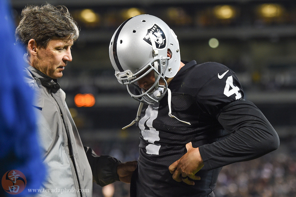 August 15, 2014; Oakland, CA, USA; Oakland Raiders quarterback Derek Carr (4) reacts after an injury during the fourth quarter against the Detroit Lions at O.co Coliseum.