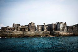 """August 8, 2017 - Nagasaki, Nagasaki Prefecture, Japan - The Hashima Island, commonly known as Gunkanjima or """"Battleship Island'' in Nagasaki Prefecture, southern Japan on August 8, 2017. The island was a coal mining facility until its closure in 1974 is a symbol of the rapid industrialization of Japan, a reminder of its dark history as a site of forced labor during the Second World War. The island now is recognized as UNESCO's World Heritage sites of Japan's Meiji Industrial Revolution. (Credit Image: © Richard Atrero De Guzman/NurPhoto via ZUMA Press)"""