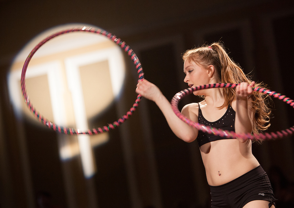 Hannah Stanton-Gockel performs with hula hoops at the Sixth Annual International Women's Day Festival, held in Baker Center Ballroom on March 16, 2014. The event, sponsored in part by the Ohio University Women's Center, educated audiences about women's progress, celebrated women's achievements, and included numerous performances by female members of the Athens and Ohio University community. International Women's Day itself fell on March 8, 2014. Photo by Lauren Pond
