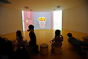 Children watch an educational video on the invention of instant noodles at the Momofuku Ando Instant Ramen Museum in Osaka, Japan on 20 October 2008. Instant noodle inventor Ando spent considerable time inventing the noodles in a shack located in the backyard of his Osaka home in 1958..
