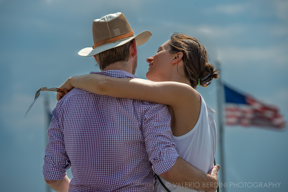 A couple embraces at the end of the solar eclipse in Washington, D.C.