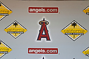 ANAHEIM, CA - JULY 21:  The team logo and corporate logos adorn the dugout wall prior to the Los Angeles Angels of Anaheim game against the Texas Rangers on July 21, 2011 at Angel Stadium in Anaheim, California. The Angels won the game in a 1-0 shutout. (Photo by Paul Spinelli/MLB Photos via Getty Images)