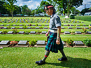"11 NOVEMBER 2018 - KANCHANABURI, KANCHANABURI, THAILAND: A Scottish veteran of the British army looks for the headstones of Scottish soldiers buried in Kanchanaburi War Cemetery during the Rememberance Day ceremony in Kanchanaburi, Thailand. Kanchanaburi is the location of the infamous ""Bridge On the River Kwai"" and was known for the ""Death Railway"" built by Japan during World War II using allied, principally British, Australian and Dutch, prisoners of war as slave labor. There are 6,982 people buried in the cemetery, including 5,000 Commonwealth soldiers and 1,800 Dutch soldiers. November 11, 2018 marked the 100th anniversary of the end of World War I, celebrated as Rememberance Day in the UK and the Commonwealth and Veterans' Day in the US.     PHOTO BY JACK KURTZ"