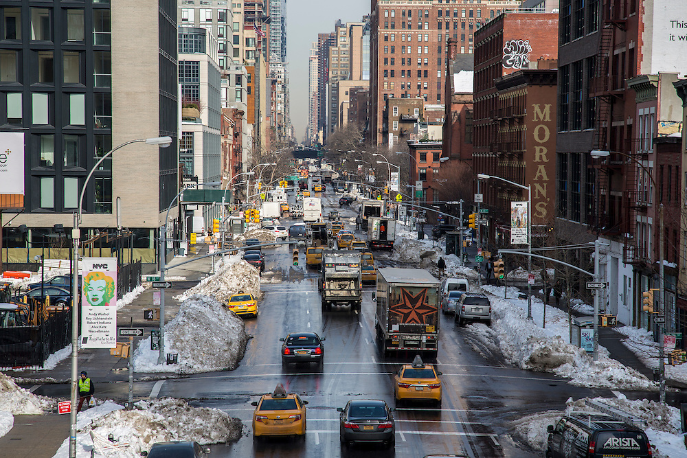 Yellow Taxis and trucks drive along 10th Avenue in Chelsea, New York City, New York , United States of America.  The city has just experienced a record breaking snowstorm and the side of the streets are still covered in snow mounds.(photo by Andrew Aitchison / In pictures via Getty Images)