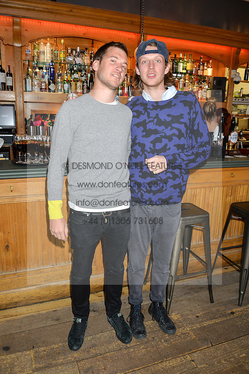 Left to right, KYLE JORDAN and OLLIE FEATHER at a quiz night hosted by Zoe Jordan to celebrate the launch of her men's ZJKNITLAB collection held at The Larrick Pub, 32 Crawford Place, London on 20th April 2016.