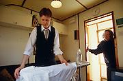 Royal Scotsman Steward Donald Allen ironing his shirts.