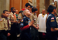 6 FEB. 2011 -- ST. LOUIS -- Scouts enter the Cathedral Basilica of St. Louis for the 2011 Scout Sunday prayer service Sunday, Feb. 6, 2011. Venture Scouts, Cub Scouts and Boy Scouts from across the Archdiocese were honored, with Bishop Edward M. Rice leading the service. Photo © copyright 2011 Sid Hastings.