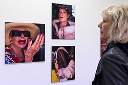 "© Licensed to London News Pictures. 28/03/2018. LONDON, UK.  Preview of ""The Series"", an exhibition by Glaswegian street photographer Dougie Wallace at Bermondsey Project Space from 27 March to 14 April.  Works on display are from diverse subjects such as the mega-rich in Harrodsburg, Shoreditch, Blackpool as well as his latest project ""Well Heeled"", a street photography book with dogs as the subject.  Photo credit: Stephen Chung/LNP"