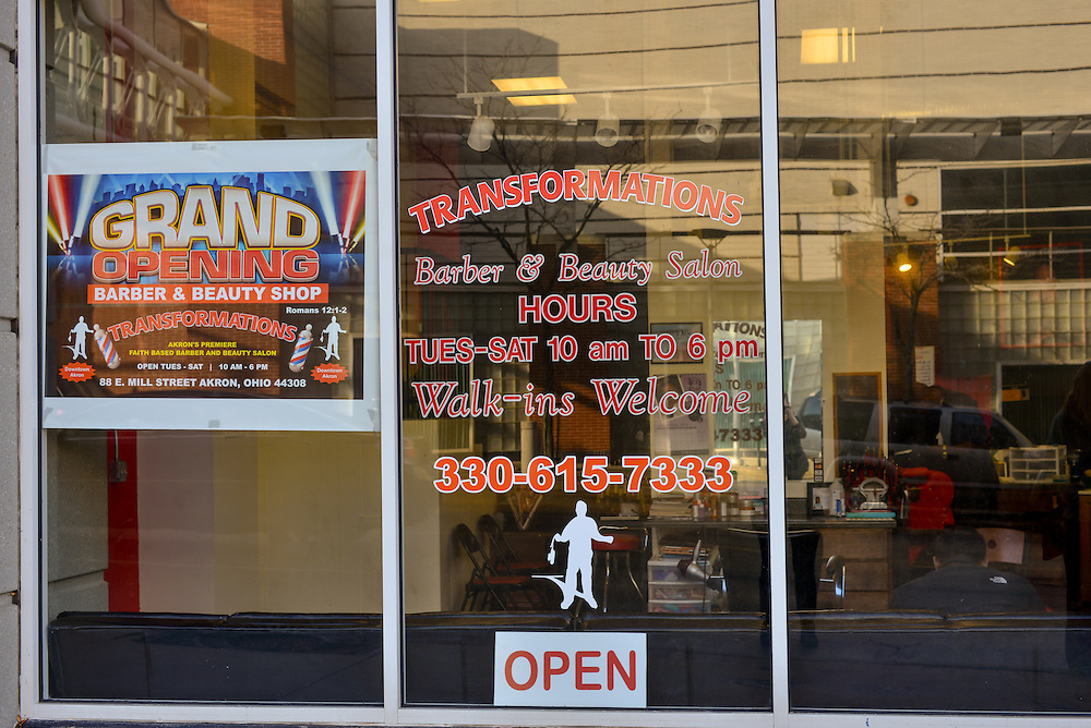 Store front window of Transformations Barber and Beauty Salon.