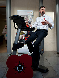 MSP's and staff from the Scottish Parliament hope to cycle the equivalent distance from Edinburgh to Glasgow to raise awareness for Poppy Scotland.<br /> <br />  Pictured: Scottish Parliament Presiding Officer Ken MacIntosh tests out the bike at the start of the challenge.<br /> <br /> &copy; Dave Johnston/ EEm