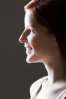 Young woman smiling side view portrait