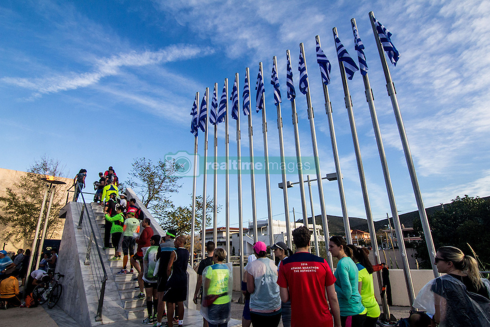 November 13, 2016 - Athens, Greece - Runners take pictures at the point where the flame of the race is lit. The 34st Athens Authentic Marathon marks the 120th anniversary of the first contemporary Marathon race in 1896. The event is inspired by the ancient hemerodromos that run from Marathonas to Athens to bring the victorious news of the battle against Persians in 480 BC. The race of 1896 was won by the Greek Spiros Louis. The event is dedicated to Grigoris Lambrakis, a doctor, Balkan Athletic Games champion and pacifist. At the Marathon race more than 18000 athletes competed, making a new record of participants. (Credit Image: © Kostas Pikoulas/Pacific Press via ZUMA Wire)