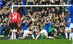 LIVERPOOL, ENGLAND - Saturday, February 20, 2010: Everton's captain Phil Neville and John Heitinga can only watch as Manchester United's Dimitar Berbatov scores the opening goal during the Premiership match at Goodison Park. (Photo by: David Rawcliffe/Propaganda)