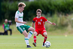 WREXHAM, WALES - Thursday, August 15, 2019: Wales' captain Paige Wilding and Northern Ireland's Daniel Kirk during the UEFA Under-15's Development Tournament match between Wales and Northern Ireland at Colliers Park. (Pic by Paul Greenwood/Propaganda) Jamie Donley