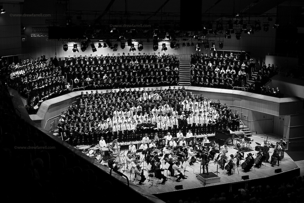 Over 650 singers from nine NYCoS Area Choirs throughout Scotland with the black shirts of the Changed Voice section of NYCoS National Boys Choir, conducted by Christopher Bell and joined by the Orchestra of Scottish Opera perform Tom Cunningham's specially commissioned 'Seven Plantets and a Cosmic Rock ' at The Royal Concert Hall.  Actor Billy Boyd, patron of the National Boys Choir, narrated this section of the show..Glasgow. Sunday 8th May 2011.Picture Drew Farrell.Tel : 07721-735041..Note to Editors:  This image is free to be used editorially in the promotion of the NYCOS. Without prejudice ALL other licences without prior consent will be deemed a breach of copyright under the 1988. Copyright Design and Patents Act  and will be subject to payment or legal action, where appropriate. For further information please contact Vicky Tibbitt Marketing and Communications Manager 0141-287-2801..