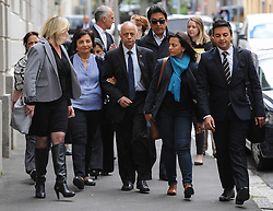 © Licensed to London News Pictures. 08/10/14. CAPE TOWN, SOUTH AFRICA -   Prakash Dewani (middle, father of Shrien Dewani, walks with family members towards the entrance of the court building during Day 3 of the Shrien Dewani trial at the Cape High Court before Judge Jeanette Traverso. Dewani is caused of hiring hit men to murder his wife, Anni. Anni Ninna Dewani (née Hindocha; 12 March 1982 – 13 November 2010) was a Swedish woman who, while on her honeymoon in South Africa, was kidnapped and then murdered in Gugulethu township near Cape Town on 13 November 2010. Photo credit : Roger Sedres/LNP