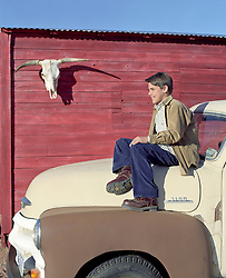 boy sitting on an old truck in Santa Fe, New Mexico