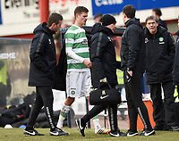 07/02/15 WILLIAM HILL SCOTTISH CUP 5TH RND<br /> DUNDEE v CELTIC<br /> DENS PARK - DUNDEE<br /> Celtic's Mikael Lustig is substituted after picking up an injury