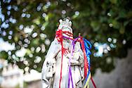 Detalle de una virgen en el cementerio durante la festividad del Corpus Christi, representada en Venezuela a traves del ritual magico-religioso de los Diablos Danzantes. Los Diablos de Naiguata se identifican por pintar sus propios trajes y decorarlos con cruces, rayas y circulos, figuras que impiden que el maligno los domine. Las mascaras son en su gran mayoria animales marinos. Llevan escapularios cruzados, crucifijos y cruces de palma bendita. Naiguata, 30 Mayo 2013. (ivan gonzalez)