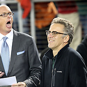 ESPN's Scott Van Pelt tries to brighten up the evening for ESPN Co-worker, Neil Everett, a graduate of the University of Oregon.  The Stanford Cardinals upset the Oregon Ducks 26-20 at Stanford Stadium.  11/7/13, 3:30pm, Photo by Barry Markowitz