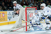KELOWNA, CANADA - OCTOBER 9: Tyson Baillie #24 of Kelowna Rockets is checked by Chaz Reddekopp #29 behind the net of the Coleman Vollrath #35 of Victoria Royals on OCTOBER 9, 2015 at Prospera Place in Kelowna, British Columbia, Canada.  (Photo by Marissa Baecker/Getty Images)  *** Local Caption *** Chaz Reddekopp; Tyson Baillie; Coleman Vollrath;