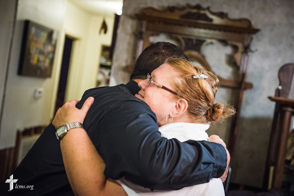 The Rev. Ross Johnson, director of LCMS Disaster Response, hugs Paulette Parker, a parishioner of Trinity Lutheran Church, Baton Rouge, La., following fellowship, devotion and prayer at her home on Tuesday evening, Sept. 13, 2016, in Baton Rouge. Her and her husband Joseph Parker suffered damage to their home from August flooding. Also present, and not pictured, is the Rev. David Buss, senior pastor at Trinity, and the Rev. Ruben Dominguez, pastor at El Buen Lutheran Church, McAllen, Texas.  LCMS Communications/Erik M. Lunsford
